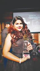 Meroshana and her VIMA award.