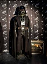 "Items up for auction at the Prop Store Auction in late August are on display at the Prop Store in Valencia, California on July 15, 2020 including Darth Vader's helmet and costume from the movie ""Star Wars"" estimated at $150,000-250,000 USD. / AFP / Frederic J. BROWN / TO GO WITH AFP STORY by Ben SHEPPARD"