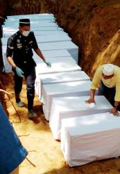 The remains of five orang asli from the Batek tribe being buried at Tanah Perkuburan Islam Kampung Kuala Koh, Gua Musang on June 23, 2019. — BBX