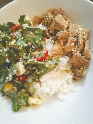 Kale salad with garlic butter pork in rice bowl
