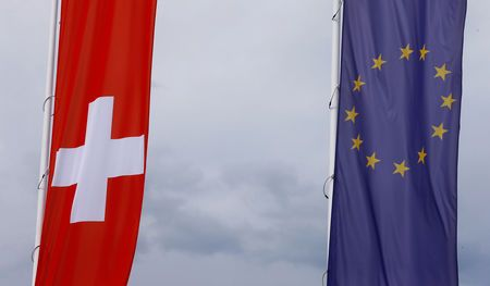 The flags of the European Union and Switzerland flutter in the wind in Blotzheim, France, on June 27, 2017. — Reuters