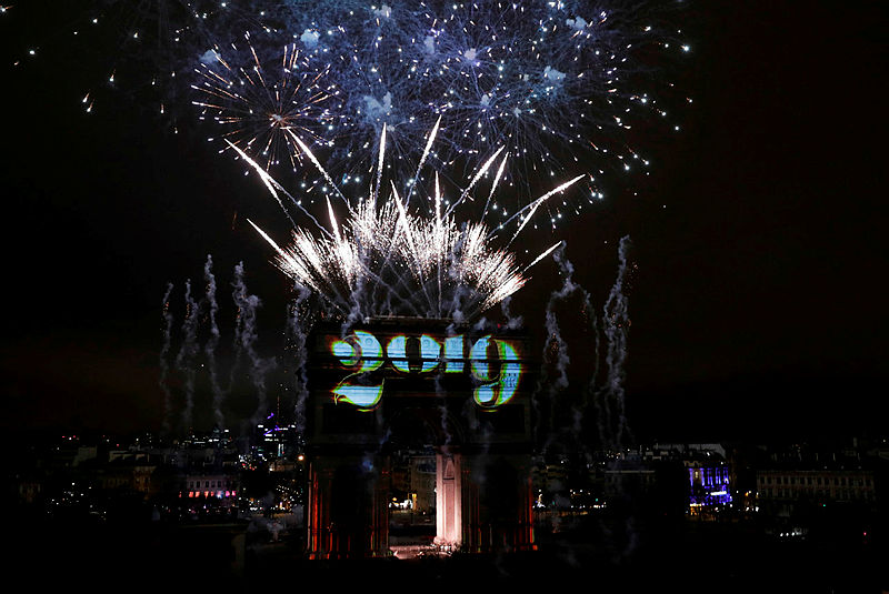 A sound and light show under the theme 'fraternity' is seen from the terrace of the Publicis drugstore on the Arc de Triomphe on the Champs-Elysees for New Year's celebrations in the French capital Paris on Jan 1, 2019 — AFP