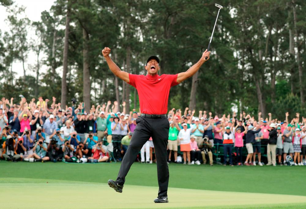 FILE PHOTO: Golf - Masters - Augusta National Golf Club - Augusta, Georgia, U.S. - April 14, 2019. Tiger Woods of the U.S. celebrates on the 18th hole to win the 2019 Masters.- Reuters