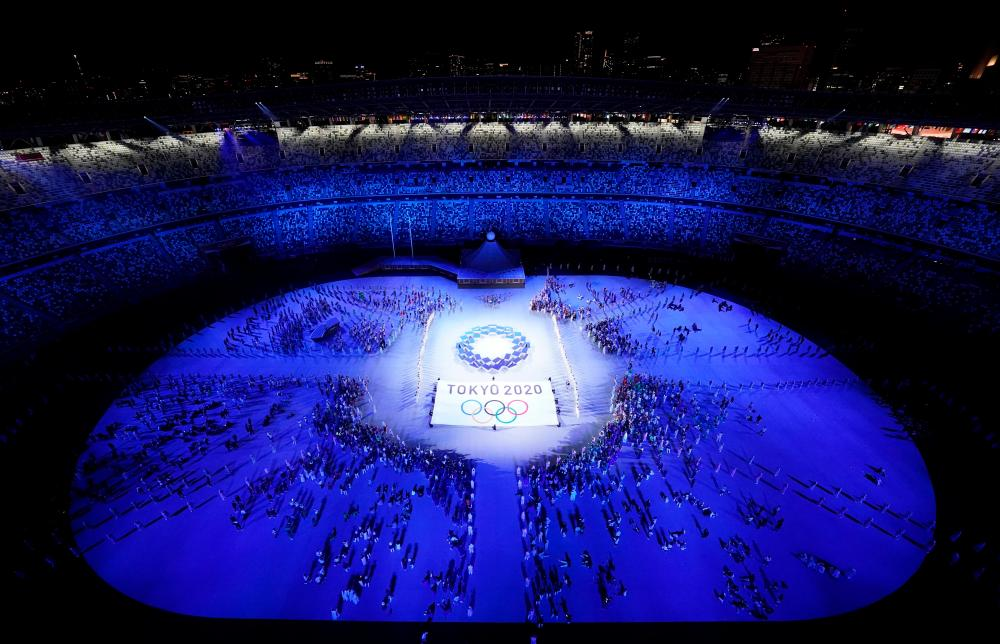 Tokyo 2020 Olympics flag and logo are seen during the opening ceremony -Reuters