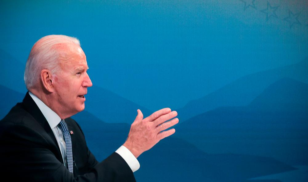 US President Joe Biden gestures as he meets with governors virtually to discuss efforts to strengthen wildfire prevention, preparedness and response efforts, at the South Court Auditorium at the White House complex in Washington, US, July 30, 2021. -Reuters
