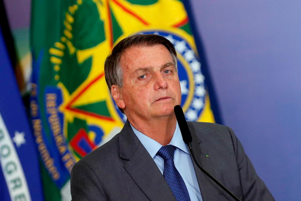 FILE PHOTO: Brazil's President Jair Bolsonaro talks during a ceremony of signing a decree establishing the Public Integrity System of the Federal government at the Planalto Palace in Brasilia, Brazil July 27, 2021. -Reuters
