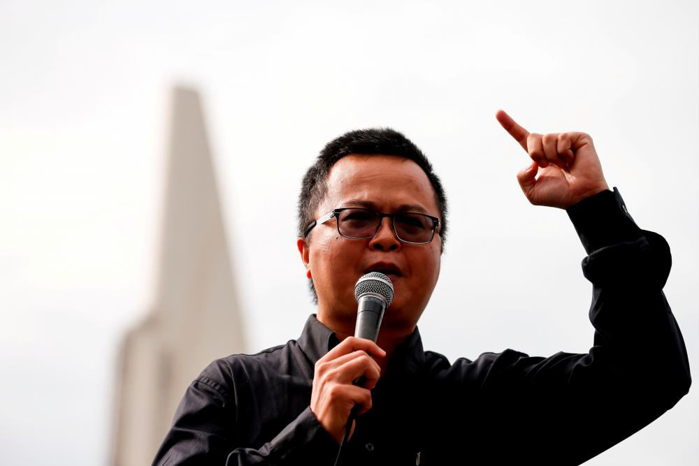 FILE PHOTO: Human rights lawyer Arnon Nampa speaks during a Thai anti-government mass protest, on the 47th anniversary of the 1973 student uprising, in front of the Democracy monument, in Bangkok, Thailand October 14, 2020.-Reuters