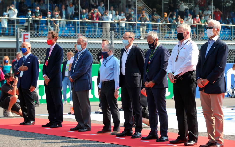 FIA President Jean Todt, Ferrari CEI Benedetto Vigna, CEO of Exor John Elkann, President of the Italian National Olympic Committee Giovanni Malago, CEO of the Formula One Group Stefano Domenicali, Executive Chairman of the Formula One Group Chase Carey and Managing Director of Motorsports at Formula One Ross Brawn stand for the Italian national anthem on the grid before the match – REUTERSPIX