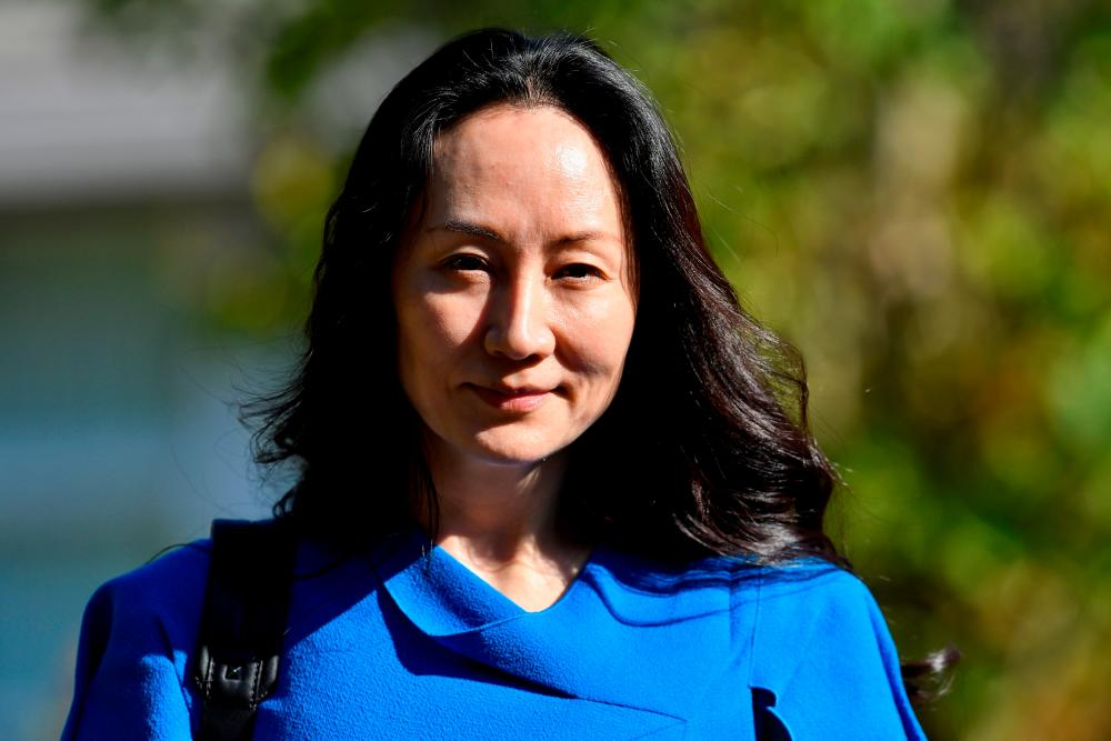 FILE PHOTO: Huawei Technologies Chief Financial Officer Meng Wanzhou leaves her home to attend a court hearing in Vancouver, British Columbia, Canada, August 4, 2021. REUTERSpix