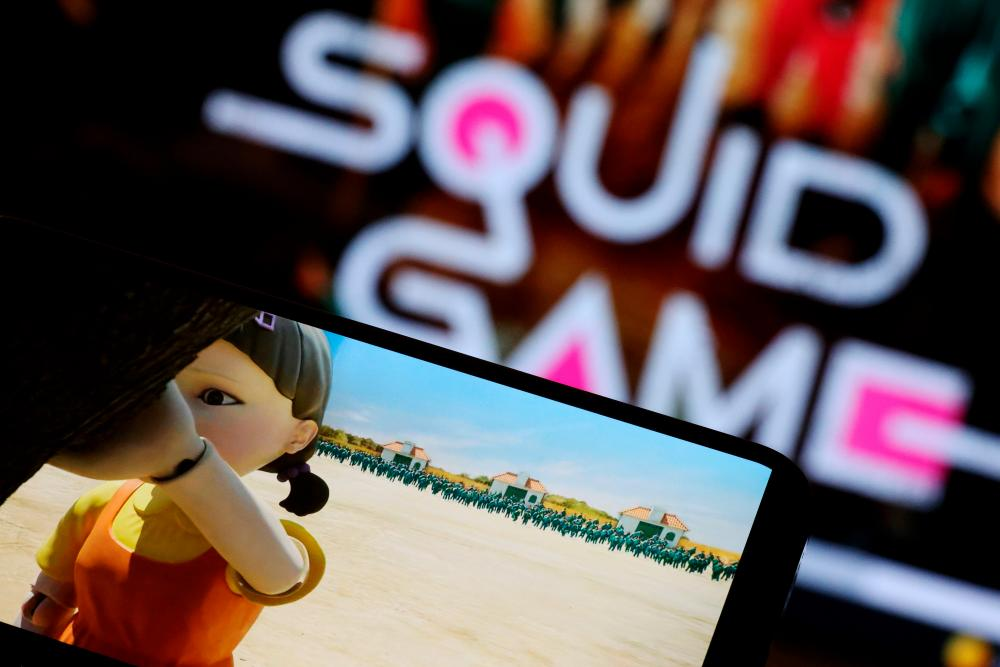 """The Netflix series """"Squid Game"""" is played on a mobile phone in this picture illustration taken September 30, 2021. REUTERSpix"""