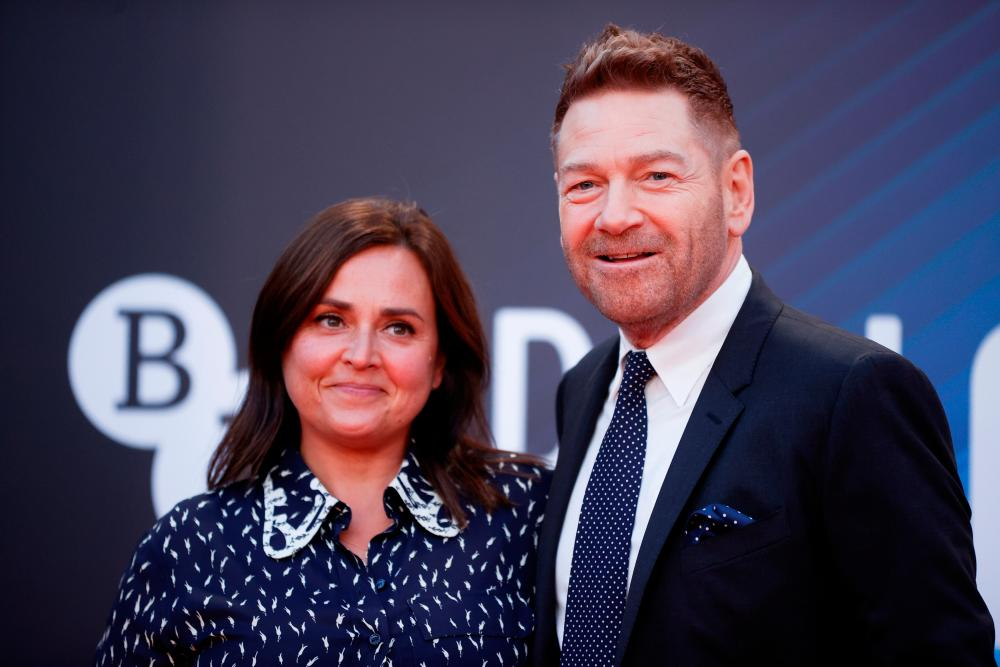 """Director Kenneth Branagh and his wife Lindsay Brunnock arrive at a screening of the film """"Belfast"""" as part of the BFI London Film Festival in London, Britain October 12, 2021. REUTERSpix"""
