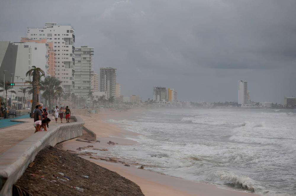 Tourists walk along the Malecon as storm Pamela approaches the Pacific coast resort, in Mazatlan, Mexico, October 12, 2021. REUTERSpix