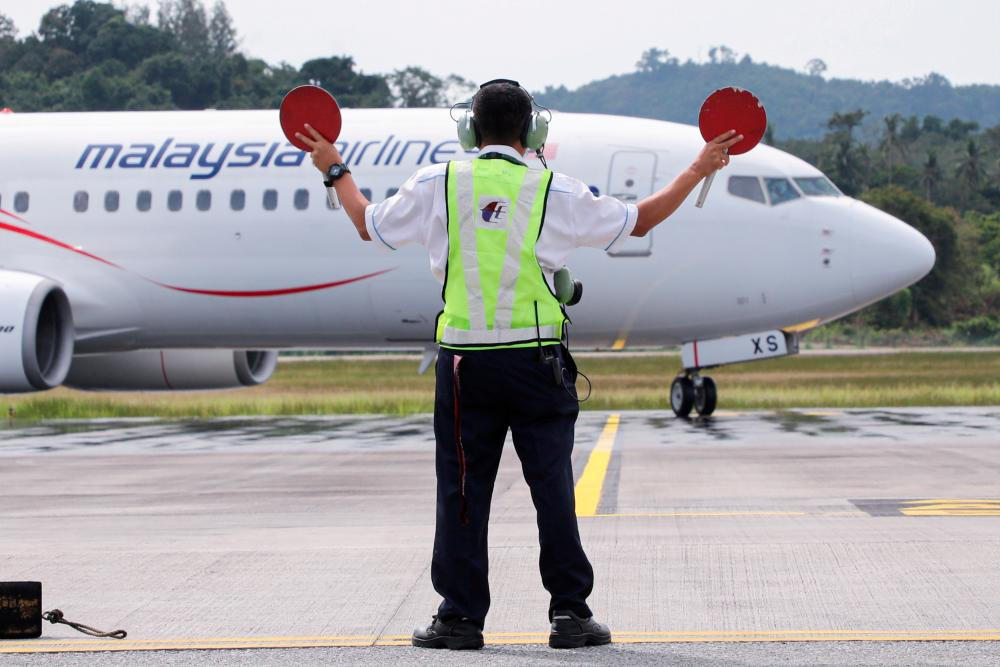 A Malaysia Airlines plane carrying the first batch of tourists arrives as Langkawi reopens to domestic tourists, amid the coronavirus disease (Covid-19) pandemic, in Malaysia September 16, 2021. REUTERSpix