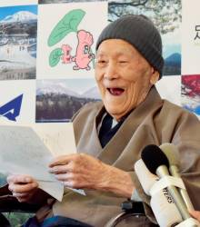 This file photo taken on April 10, 2018 shows Masazo Nonaka of Japan, then aged 112, smiling after being awarded the Guinness World Records' oldest male person living title in Ashoro, Hokkaido prefecture. — AFP / Jiji Press