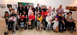 Wan Marzimin and Shahril Azuar with guests artists and children at the exhibition.
