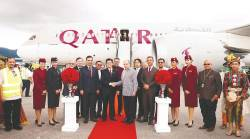 Qatar Airways Group chief executive officer Akbar Al Baker (front row in grey) shaking hands with Malaysia Airport Holdings chief operating officer Datuk Mohd Shukrie Mohd Salleh at the welcoming ceremony. – QATAR AIRWAYS