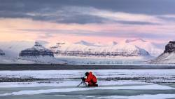 Camera Operator Steve Gute photographs the Tempelfyorden, Svalbard, Norwegian Territory- HBO