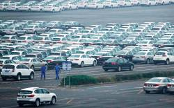 Newly manufactured cars are seen at the automobile terminal in the port of Dalian, Liaoning province, China. REUTERSPIX