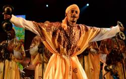 A member of Gnaoua (Gnawa) group Maalem Mohamed Kouyou performs in Essaouira at the Gnaoua World Music Festival on June 14, 2014. © Fadel SENNA / AFP