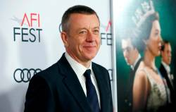 "Creator Peter Morgan poses at a premiere for the season 3 of ""The Crown"" during AFI Fest 2019 in Los Angeles, California, U.S., November 16, 2019. REUTERS/Mario Anzuoni/File Photo"