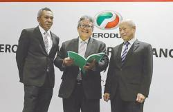 Zainal (centre), together with Perodua Sales Sdn Bhd managing director Datuk Dr Zahari Husin (left) and Perodua Auto Corp Sdn Bhd president Masanori Takahashi at the media briefing on Perodua's first-half performance review. – ASYRAF RASID/THE SUN