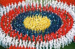 COLORS OF A NATION ... Combined Selangor Schools student swirl as they form the Jalur Gemilang during the 43rd Merdeka Day Celebration in the year 2000.