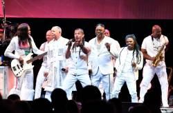 "In this file photo taken on July 9, 2019 Earth, Wind & Fire perform at The Beacon Theatre in New York City. The iconic children's television program ""Sesame Street"" along with the R&B collective Earth, Wind & Fire will be among those honored at this year's Kennedy Center Honors, one of America's most prestigious arts awards. The Kennedy Center -- Washington's performing arts complex that serves as a living monument to slain president John F. Kennedy -- announced July 18, 2019 that actress Sally Field, genre-spanning singer Linda Ronstadt and 11-time Grammy winning conductor Michael Tilson Thomas would also be among the 2019 class. / AFP / GETTY IMAGES NORTH AMERICA / Dimitrios Kambouris"