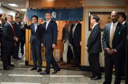 This file photo taken on April 23, 2014 shows US President Barack Obama (C) and Japan's Prime Minister Shinzo Abe (2nd L) departing after a private dinner at the Sukiyabashi Jiro restaurant in Tokyo. © Jim WATSON / AFP