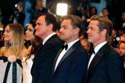 "72nd Cannes Film Festival - After the screening of the film ""Once Upon a Time in Hollywood"" in competition - Red Carpet - Cannes, France, May 21, 2019. Director Quentin Tarantino, his wife Daniella Pick, cast members Brad Pitt, Leonardo DiCaprio and Margot Robbie pose. REUTERS/Regis Duvignau"
