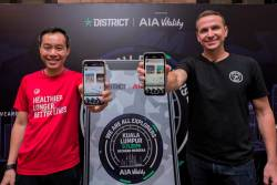 From left: Heng and Pember launching the District Race app in Malaysia.