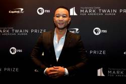 John Legend arrives ahead of comedian Dave Chappelle receiving the Mark Twain Prize for American Humor at the Kennedy Center in Washington, U.S., October 27, 2019. REUTERS/Yuri Gripas/File Photo