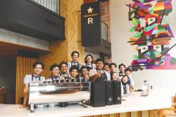 Staff are all smiles at the newly opened Starbucks Reserve Bukit Bintang Junction. – STARBUCKS MALAYSIA