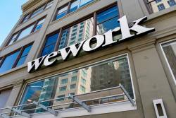 FILE PHOTO: A WeWork logo is seen outside its offices in San Francisco, California, U.S. September 30, 2019. REUTERSPIX