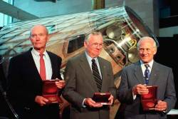 The crew of Apollo 11 (l-R) Michael Collins, Neil Armstrong and Buzz Aldrin stand in front of the Apollo command module Columbia