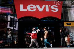People walk by a Manhattan Levi's clothing store on March 19, 2019 in New York City - AFPPIX