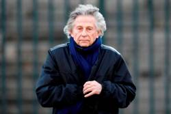 Film director Roman Polanski arrives at the Madeleine Church to attend a ceremony during a 'popular tribute' to late French singer and actor Johnny Hallyday in Paris, France, December 9, 2017. REUTERS/Charles Platiau/File Photo