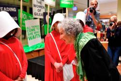 Author Margaret Atwood speaks with people dressed as hand maidens from The Handmaid's Tale, after reading an extract from her new novel The Testaments during the book launch at a book store in London, Britain September 9, 2019. REUTERS/Dylan Martinez