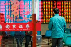 A man enters a stock brokerage office of Nanjing Securities in Nanjing, Jiangsu province, China-REUTERS PIX