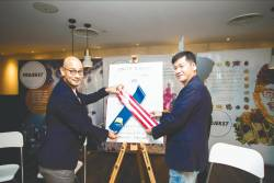 Project57 co-founders Syed Sadiq and Swee with the Unity Ribbon.