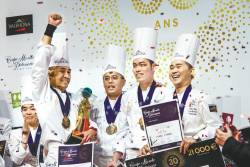 World pastry champions ... (from left) Siau, Loi, Tan and Tay in Lyon, France. – DIPH PHOTOGRAPHY/ FRENCH EMBASSY IN MALAYSIA