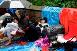 File picture of fans of the Korean K-Pop band BTS waiting in the rain outside Central Park in New York a day ahead of a concert performance. New York City, New York, U.S., May 14, 2019. REUTERS/Mike Segar/File Photo