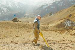 An Afghan deminer working for the Danish Demining Group scans a combat zone at Ahangaran in the central Afghan province of Bamiyan on Nov 14. – AFPpix