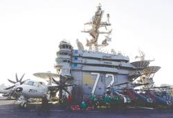 Nimitz-class aircraft carrier USS Abraham Lincoln is off the coast of Iran. With it are a nuclear submarine, a cruiser and a group of destroyers, all equipped with land-attack missiles. – Reuterspix