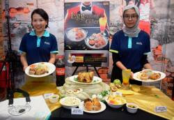 From left: Thong and Berjaya Roasters M. Sdn Bhd marketing officer Adyana Radzuan unveiling the new meal offerings.