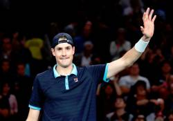 Picture shows John Isner celebrating after winning his quarter final match against Argentina's Juan Martin del Potro, Nov 3, 2017 — Reuters