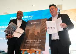 Premendran (left) and general manager of agent and developer sales Sean Liew at the launch of iProperty.com's 1H 2019 Portal Demand Analytics