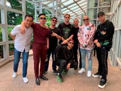 Executive vice president for market development at Universal Music Group (UMG) Adam Granite and Calvin Wong, chief executive officer for Southeast Asia and senior vice president for Asia at UMG, pose with rappers Joe Flizzow, Daboyway, Yung Raja, Fariz Jabba, ALIF and A.Nayaka in Singapore September 17, 2019. Universal Music Group (UMG)/Handout via REUTERS THIS IMAGE HAS BEEN SUPPLIED BY A THIRD PARTY. MANDATORY CREDIT. NO RESALES. NO ARCHIVES.