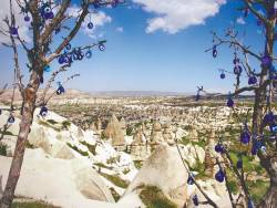 The other-wordly scene of Cappadocia flanked by potted Evil Eyes. – COURTESY OF S.S. YOGA