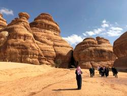 Visitors walk outside the tombs at the Madain Saleh antiquities site, al-Ula, Saudi Arabia. The kingdom wants the tourism sector to contribute 10% of gross domestic product by 2030. – REUTERSPIX