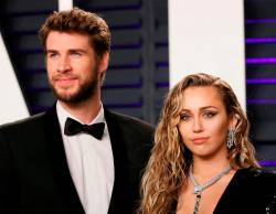 91st Academy Awards – Vanity Fair – Beverly Hills, California, U.S., February 24, 2019 – Liam Hemsworth and Miley Cyrus. REUTERS/Danny Moloshok/File Photo